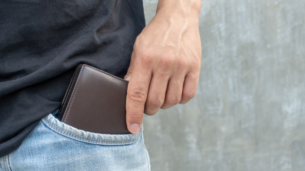 men-hold-brown-wallet-from-jeans-pocket_42546-2109